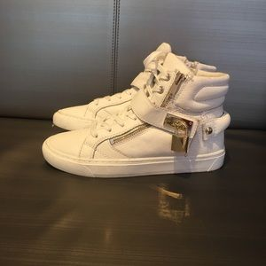 White Aldo high tops with gold accents